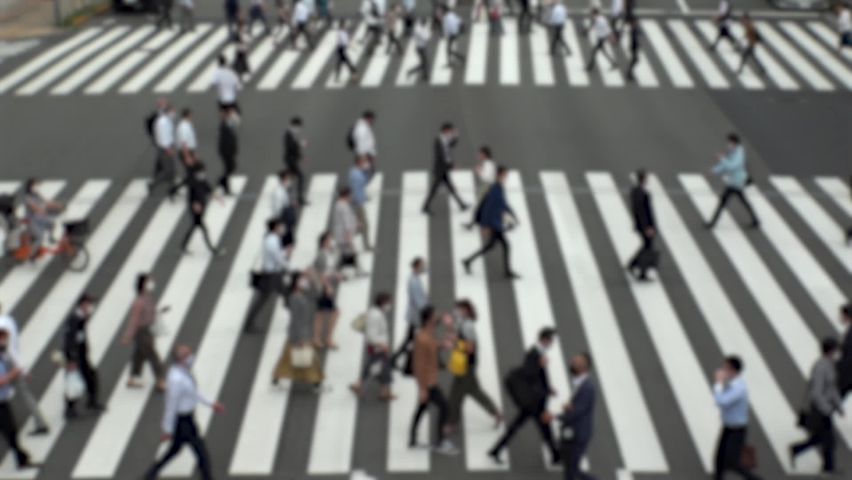 TOKYO, JAPAN : Aerial high angle view of crowd of people walking at zebra crossing in rush hour. Commuters at the street. Japanese city lifestyle, business and work concept. Slow motion blurred shot. | Shutterstock HD Video #1064086573