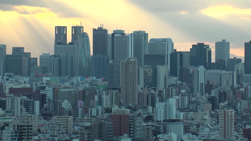 TOKYO, JAPAN : Aerial high angle sunrise CITYSCAPE of TOKYO. View of office buildings at downtown area around Shinjuku. Japanese urban metropolis concept shot. Long time lapse shot night to morning.