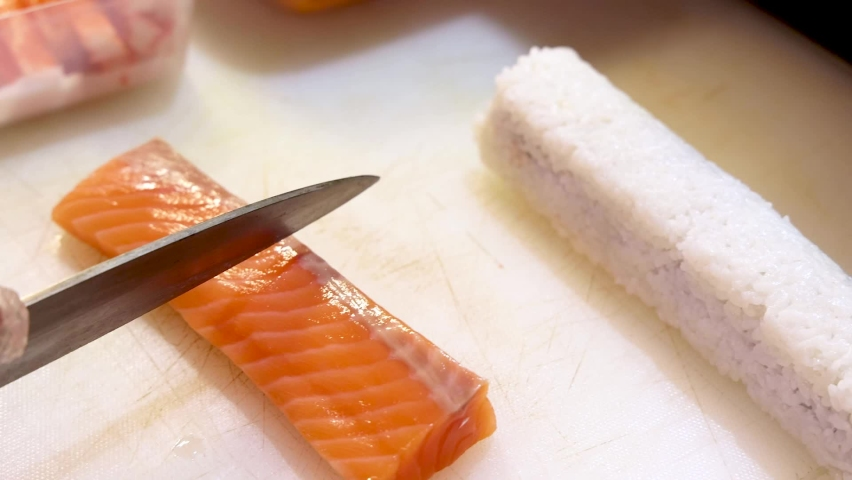 Chef sliced raw salmon for sushi | Shutterstock HD Video #1064096239