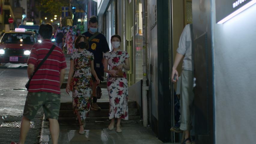 Qipao lady walking at Aberdeen Street, HONG KONG, CHINA, November 2020 | Shutterstock HD Video #1064175286