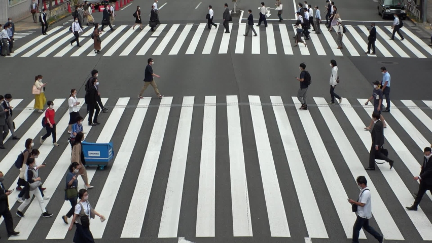 TOKYO, JAPAN - NOV 2020 : Aerial high angle view of crowd of people walking at zebra crossing in rush hour. Commuters at the street. Japanese city lifestyle, business and work concept. Slow motion. | Shutterstock HD Video #1064201749