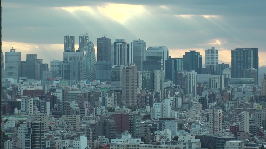 TOKYO, JAPAN : Aerial high angle sunset CITYSCAPE of TOKYO. View of office buildings at downtown area around Shinjuku. Japanese urban metropolis concept. Long time lapse shot dusk to night.