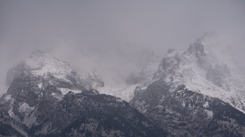 Time-lapse for Grand Teton National park with the clouds over taking the Grand Teton range.