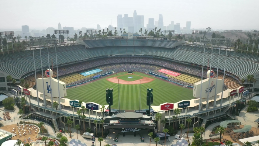 LOS ANGELES, CA, USA - NOV 15, 2020: Drone aerial shot, Slow motion 4k. Baseball stadium in downtown Los Angeles. View of LA skyline skyscrapers buildings. Urban modern city in America.