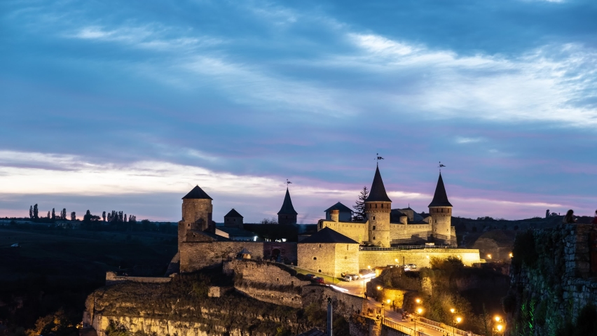 Timelapse of Illuminated Medieval Castle at night. Night footage of Kamyanets-Podilskyi Fortress in Ukraine   Shutterstock HD Video #1064514673