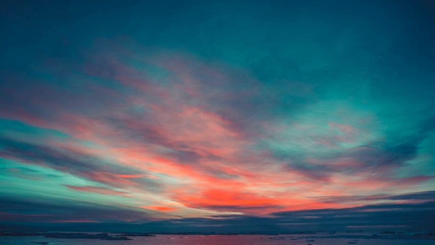 Beautiful nature colorful sunset cloudy sky bright orange clouds reflected in ocean | Shutterstock HD Video #1064528716