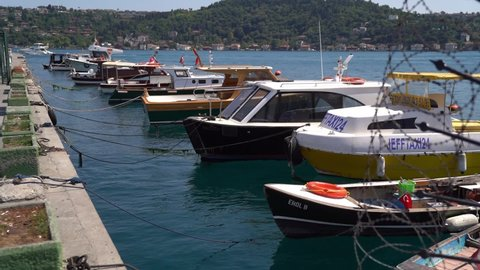Turkey Istanbul, Summer 2020: Fishing boats and yachts moored at the Karakoy port of Istanbul. Shiny sunny day, beautiful boats.