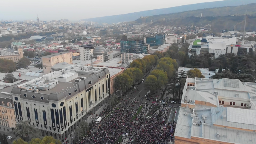 1st november, 2020. Tbilisi.Georgia.Aerial view down to crowds of perople gathered protesting in front of parliament building.Post parliament election protests in caucasus.