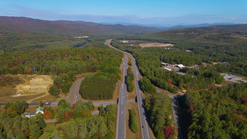 Interstate Highway 93 at Exit 23 with Pemigewasset River in White Mountain National Forest aerial view with fall foliage, Town of New Hampton, New Hampshire NH, USA.