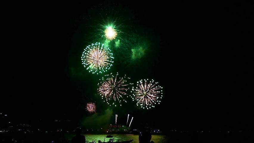 Multicolor fireworks night scene in Pattaya International Fireworks Festival, Chonburi, Thailand Royalty-Free Stock Footage #1064652499