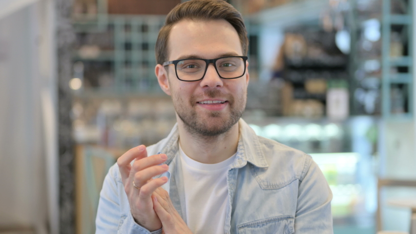 Portrait of Young Man Clapping, Applauding   Shutterstock HD Video #1064682340
