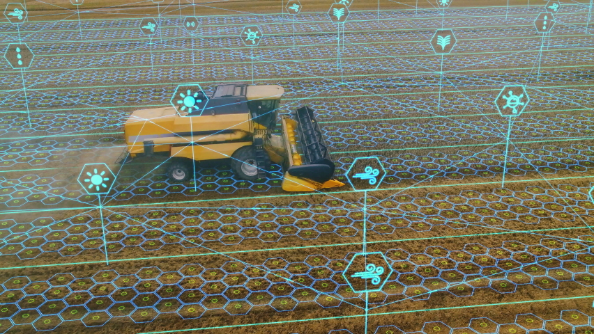 Aerial Shot: Harvester Working on Field. Digitalization of the Crops Growing Efficiency with AI Data Analysis Icons. Futuristic Agriculture Concept of Computerized, Eco, Sustainable way of Harvesting Royalty-Free Stock Footage #1064754874