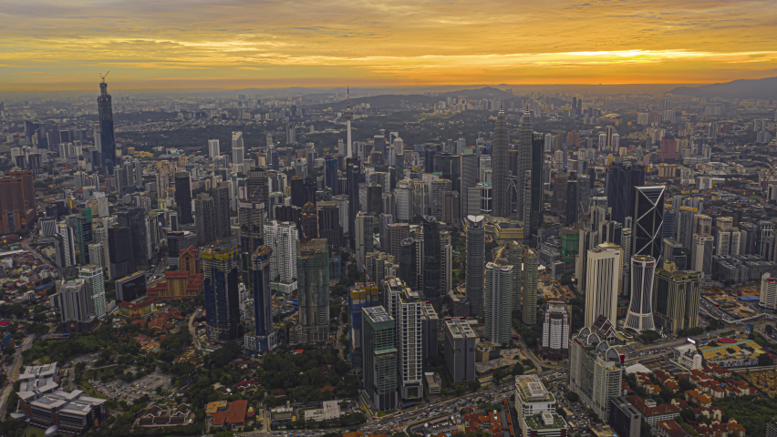 Kuala Lumpur Time Lapse: Sunset of cityscape during a golden sunset overlooking an elevated highway in Kuala Lumpur city. Malaysia. Cinematic. Golden hour. Prores 4K | Shutterstock HD Video #1064763178