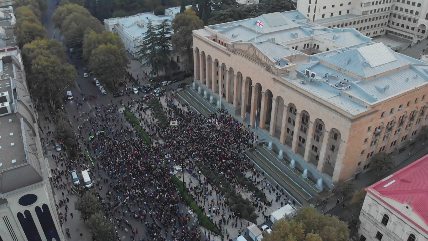 1st november, 2020. Tbilisi.Georgia.Ascending front Aerial view down to crowds of perople gathered protesting in front of parliament building.Post parliament election protests in caucasus.
