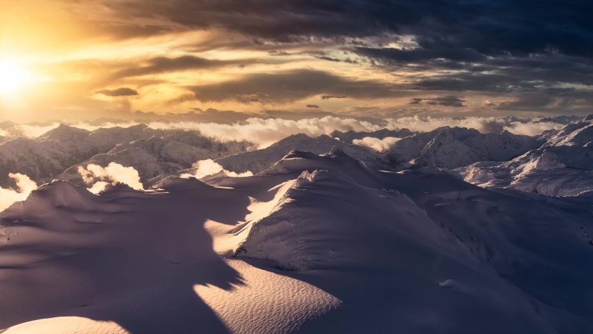 Cinemagraph Continuous Loop Animation. Aerial landscape view of the snow covered mountain range Near Vancouver and Squamish, British Columbia, Canada. Artistic Dark Render Royalty-Free Stock Footage #1064789734