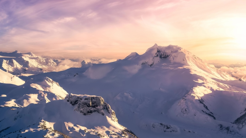 Cinemagraph Continuous Loop Animation. Aerial landscape view of the snow covered mountain range North of Vancouver, British Columbia, Canada. Artistic Dark Render Royalty-Free Stock Footage #1064789737