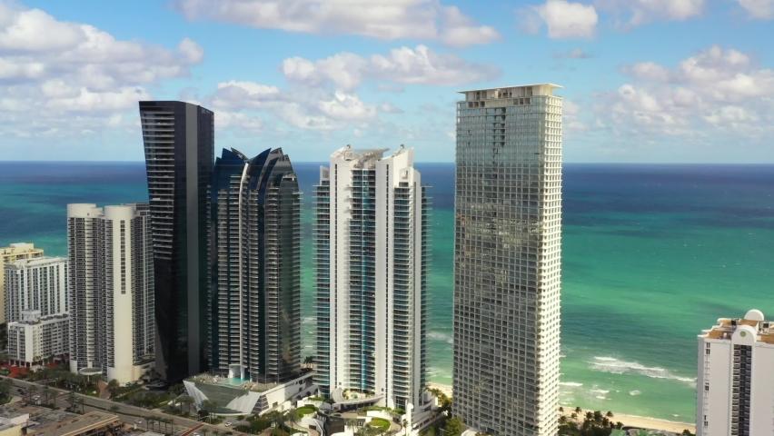 Luxury highrise condominium apartment buildings Sunny Isles Beach aerial 4k drone footage   Shutterstock HD Video #1064825215