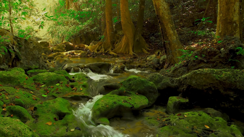 Beautiful waterfall in green forest. Natural waterfall in the tropical forest. 4K aerial view loop video footage | Shutterstock HD Video #1064827603