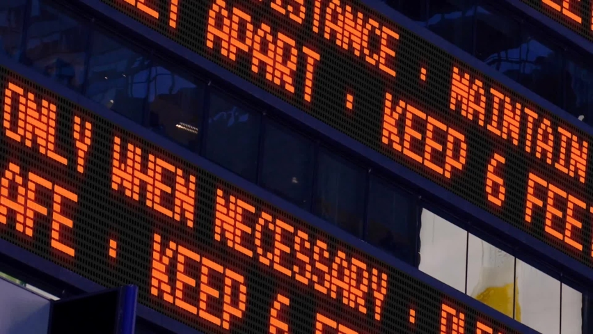 Closeup view of a times square stock market ticker reminding pedestrians to keep 6 feet apart from each other social distancing was a common practice to slow down the spread of covid19 | Shutterstock HD Video #1064858632