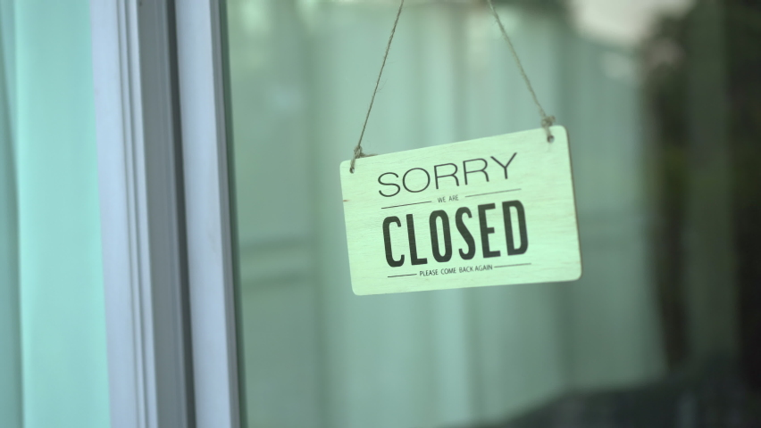 Happy Asian woman comes and turning a wooden store sign from close to open, business restore after covid-19 or coronavirus pandemic. Cheerful young girl mask off and flip a store sign to open. | Shutterstock HD Video #1064921446