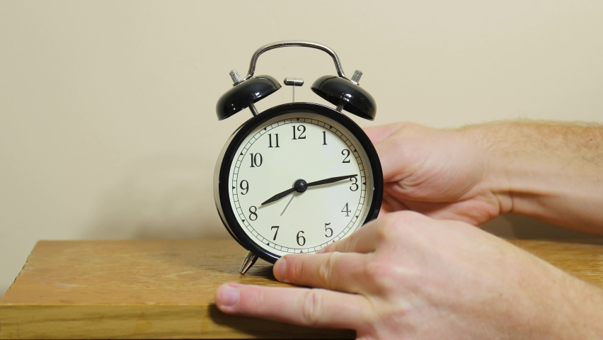 Setting clock back by one hour for ending summer daylight saving time in the autumn in October Royalty-Free Stock Footage #1064933296