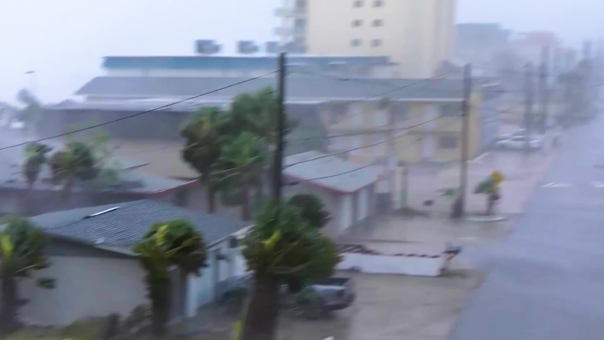 Hurricane Michael Rips Roof off House in Rockport, Texas. Hurricane winds, storm surge flooding along the coastal homes. Houses and palms in strong winds and rain