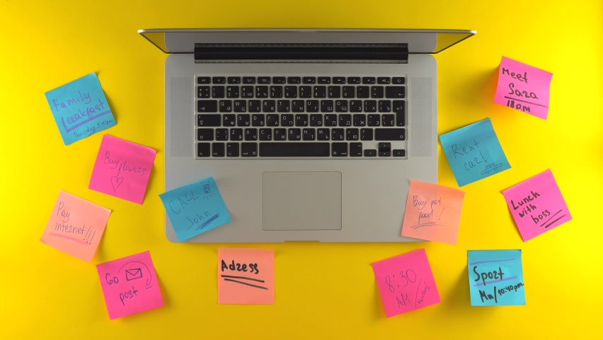 Using laptop, typing hands, post it papers on work place, remind stickers, yellow background Royalty-Free Stock Footage #1065157270