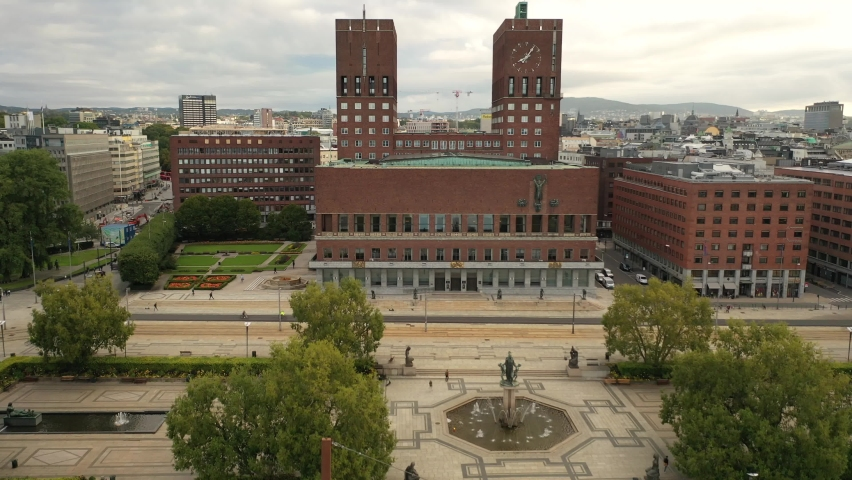 Oslo, Norway ,scandinavia. Beautiful 4K panoramic aerial video from flying drone to Oslo City Hall is a municipal building in Oslo, the capital of Norway. Against the background of port and yachts. Royalty-Free Stock Footage #1065218482