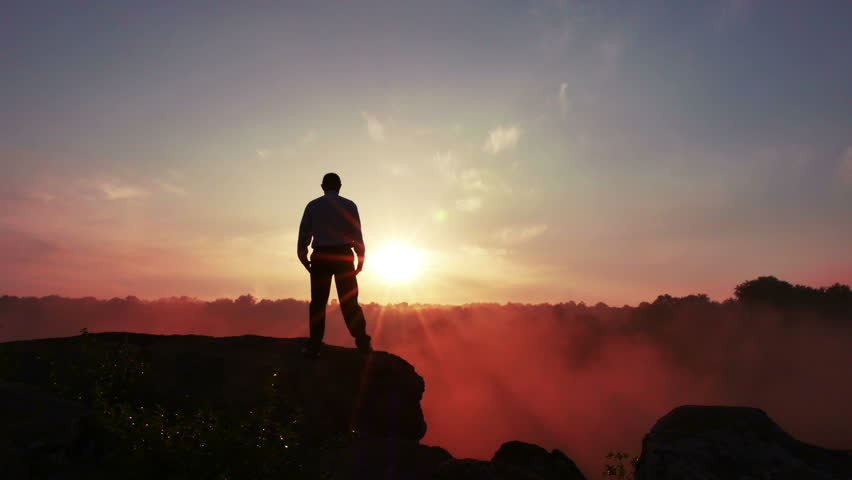 Silhouette of meditating man (prayer) at sunrise time. 4K 3840x2160   | Shutterstock HD Video #10652204