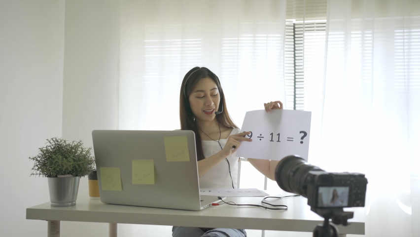The tutor teaches students mathematics via video call with laptop computers during quarantine to prevent the covid-19 virus outbreak. Royalty-Free Stock Footage #1065265099