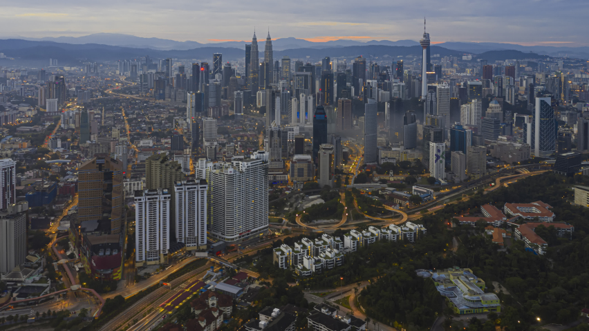 Time lapse: Kuala Lumpur city view during cloudy dawn overlooking the city skyline in Federal Territory, Malaysia. | Shutterstock HD Video #1065276493