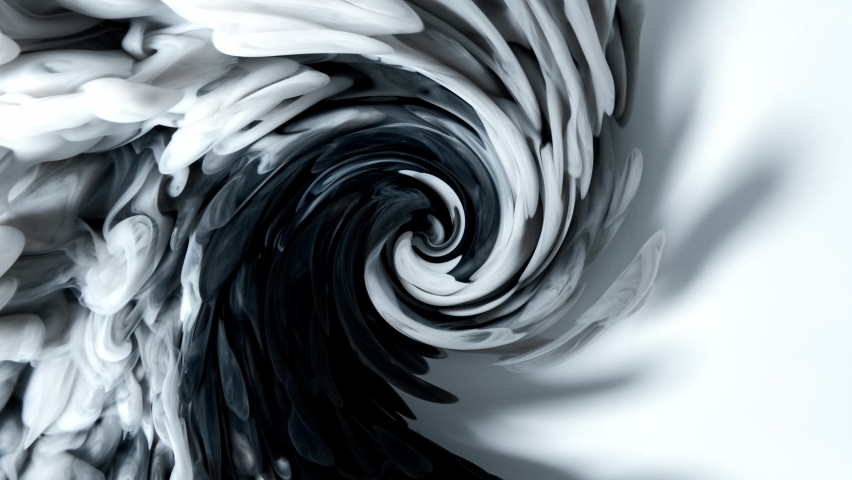 Black ink churns slowly in water. Abstract swirl background