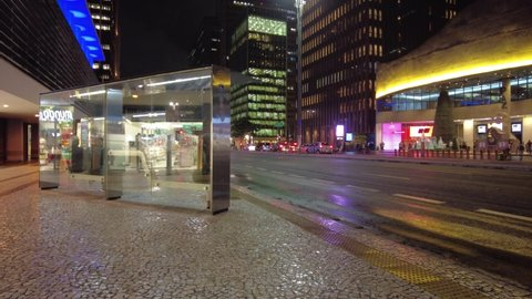 Sao Paulo, Brazil, January 06, 2021. Time Lapse of Passengers board a bus, in Paulista Avenue at night, in downtown Sao Paulo