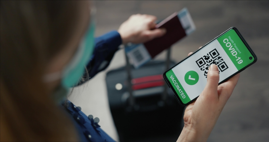 vaccinated person using digital health passport app in mobile phone with covid-19 vaccination certificate in airport for safe travel Royalty-Free Stock Footage #1065363574