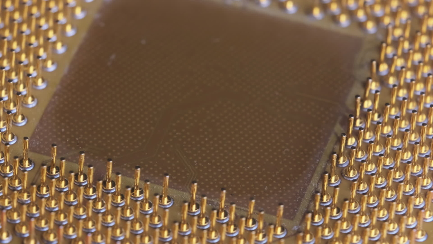 The old computer processor spins on a red background. CPU. Gold plated contacts of the microprocessor. Close-up. Chip processor computer. Central processor unit pins. Old model. Macro. Microchip Royalty-Free Stock Footage #1065395410