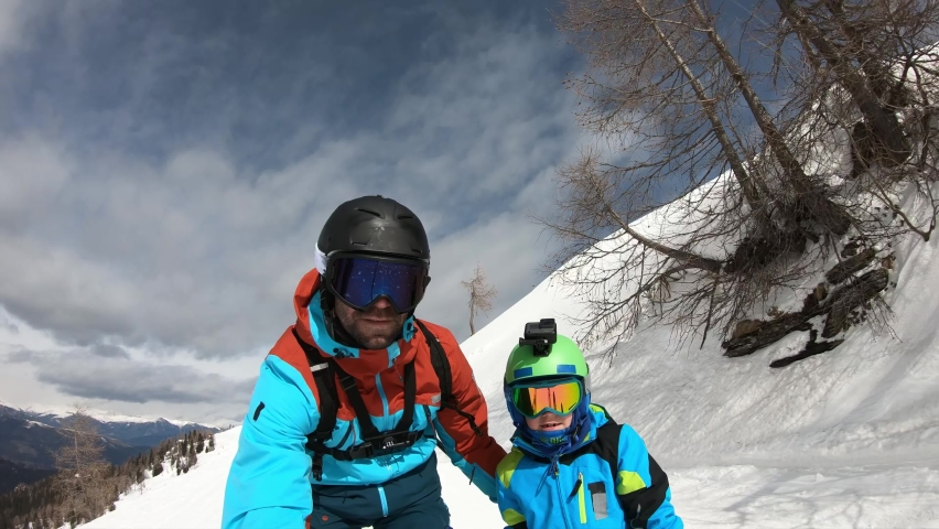 Little boy skiing in the Alps with their parents. Boy with his father. Selfie.  | Shutterstock HD Video #1065447892