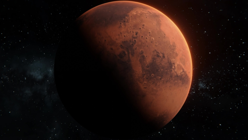 Mars planet spinning in open space over stars background. Rolling front view of Mars red planet in 4k footage. 3d mysterious planet half illuminated by the Sun