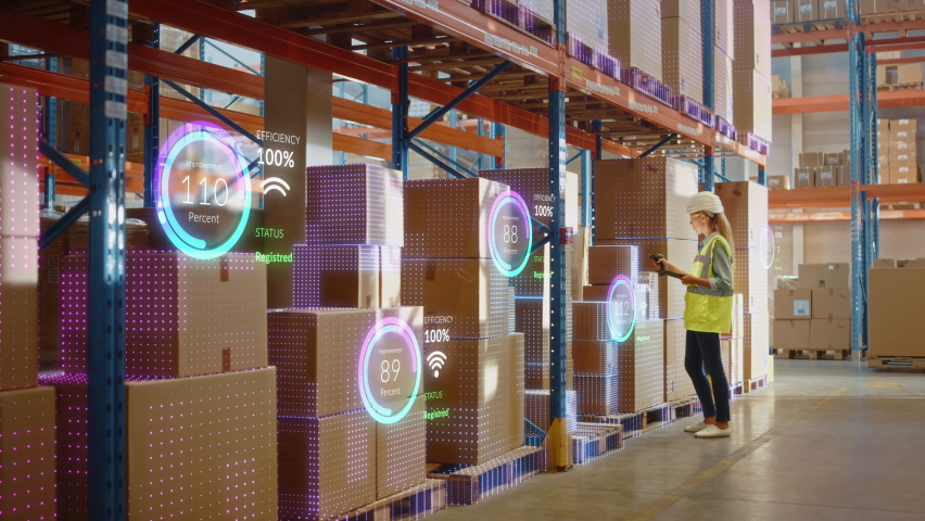 Futuristic Technology Retail Warehouse: Worker Starts Inventory Digitalization with Barcode Scanner Analyzes Goods, Cardboard Boxes, Products. Delivery Infographics in Logistics, Distribution Center | Shutterstock HD Video #1065465037