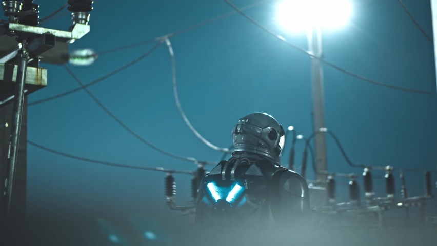 Our future and technologies. Back view of the astronaut standing at the power units station while working on sun energy farm at the evening or night. Alternative energy and solar farm concept Royalty-Free Stock Footage #1065501007