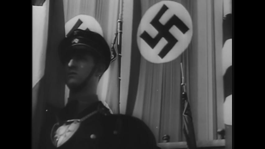 CIRCA 1940s - Adolf Hitler addresses an enormous crowd at an outdoor Nazi rally.