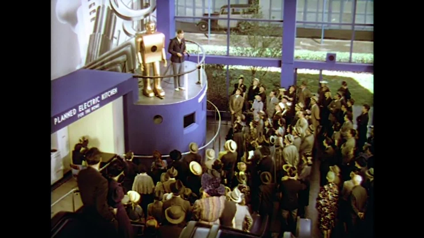 """CIRCA 1930s - A captivated audience listens as a robot tells them his """"life story"""" at the 1939 New York World's Fair."""