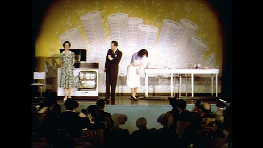 CIRCA 1930s - A contest is held at the 1939 New York World's Fair to see whether a woman can wash dishes faster by hand than a dishwashing machine..