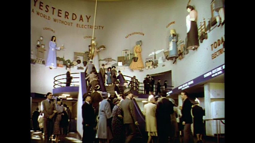 CIRCA 1930s - Seeing the opulence of the 1939 New York World's Fair spurs a young man to complain about capitalism to his girlfriend.