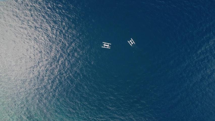 Aerial top down two fisherman boat in blue clear clean ocean water tropical paradise minimalist drone seascape   Shutterstock HD Video #1065573235