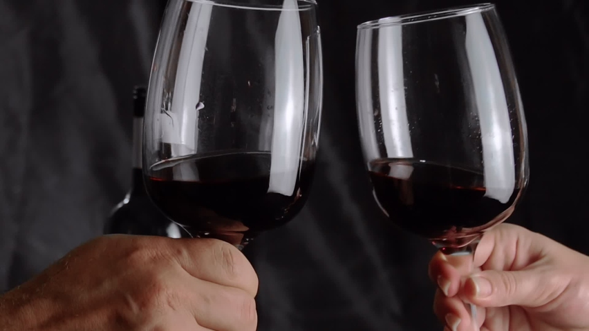 Male and female hand with glasses of wine clink glasses. Slow motion. FullHD footage | Shutterstock HD Video #1065582736
