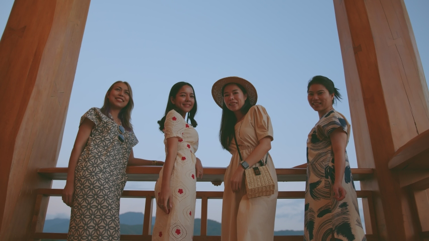 Attrative asian group of girl friends travel together walking to looking on terrace at japan temple sunset moment travel vacation ideas concept | Shutterstock HD Video #1065585967