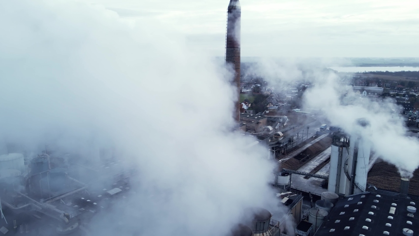 Steam and smoke from a large production factory.   Shutterstock HD Video #1065596098