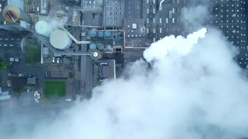 Steam and smoke from a large production factory.   Shutterstock HD Video #1065596143