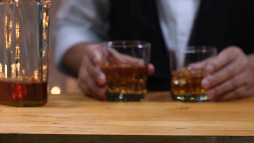 Bartender Serve Whiskey, on wood bar,   Shutterstock HD Video #1065598954