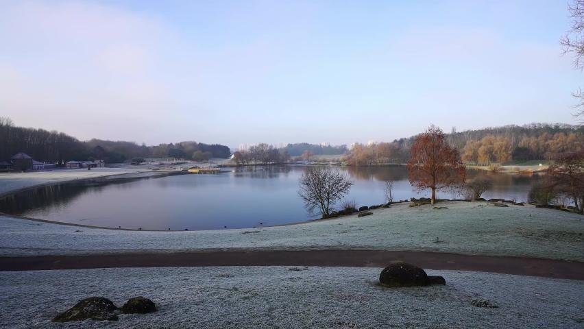 Lakescape of Tapis vert parc in La Courneuve in winter, Paris in France   Shutterstock HD Video #1065604894
